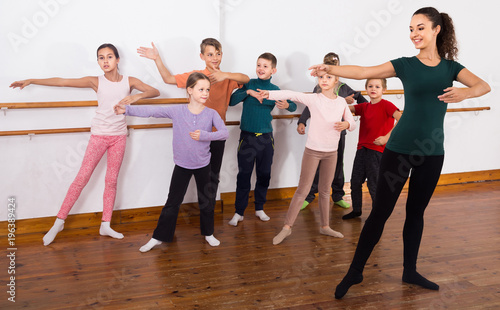 Group of children practicing at the ballet barre