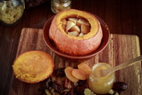 Baked pumpkin with apples, dried fruits and honey. Healthy food. - 196405260
