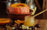 Baked pumpkin with apples, dried fruits and honey. Healthy food. - 196405407
