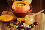 Baked pumpkin with apples, dried fruits and honey. Healthy food. - 196405438