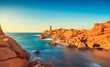 Ploumanach lighthouse sunset in pink granite coast, Brittany, France. - 196414611