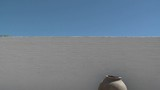 Vertical pan of brick wall and clay pot in San Pedro de Atacama, Chile. - 196416414