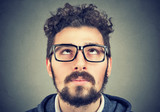 portrait of a man with glasses looking up - 196420448
