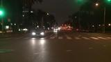 A car travels along a street at night in Santa Monica, California as seen through the rear window. - 196438643