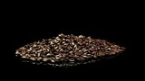 A distant shot of a pile of roasted coffee beans slowly rotating. - 196445433