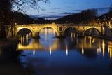 Rome. Night landscape of the Tiber river and Ponte Sisto.