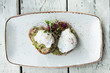 Avocado with poached eggs on toast in trendy hipster restaurant high end - 196453836