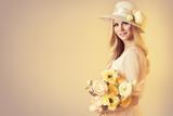 Beauty Model in Fashion Broad Brim Hat, Peony Flowers, Beautiful Woman Retro Portrait on Beige Background - 196456431