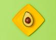 Avocado Tropical Fresh Fruit. Vegan Organic Food Concept. Flat lay. Trendy fashion Style. Minimal Design Art. Hot Summer Vibes. Green avocado on yellow plate. Bright Color.