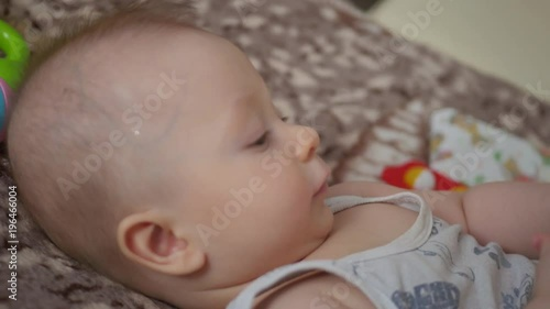Sweet little boy on bed. Baby toys concept.