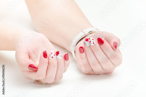 Foto op Canvas Manicure Female hands with manicure, red nail polish. White background.