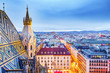 Leinwanddruck Bild - Vienna, Austria, Europe. Lovely twilight skyline view from above of Vienna. Iconic landmark and extremely popular European travel destination. View over roofs on classic architecture, dusk scenery.