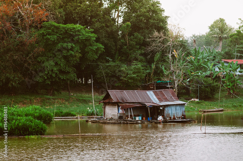 Traditional vinatge local floating house or raft house in river, Uthaithani, Thailand