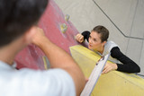 fit couple rock climbing indoors at the gym - 196490238