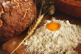 Flounder of flour and quail egg on the table next to bread and eggs - 196495413