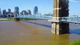 A beautiful rising aerial shot of Cincinnati Ohio with bridge crossing the Ohio River foreground. - 196498811