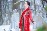 Woman in oriental dress in a winter park - 196506096
