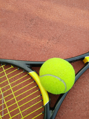 Aluminium Tennis Tennis Ball with Racket on the tennis court