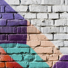 """Постер, картина, фотообои """"Abstract detail of brick wall with fragment of colorful graffiti. Urban Art close-up. With place for your text, for background use. Aerosol city design"""""""