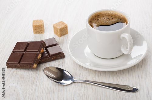 Poster Pieces of chocolate, cup of coffee on saucer, spoon, sugar
