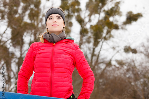 Wall mural Woman wearing sportswear exercising during winter