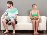 Man and woman in disagreement sitting on sofa - 196524231