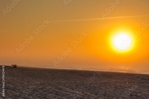 Fotobehang Strand Beatiful red sunset over sea surface