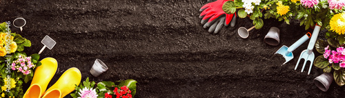 Gardening Tools on Soil Background. Spring Garden Works Concept