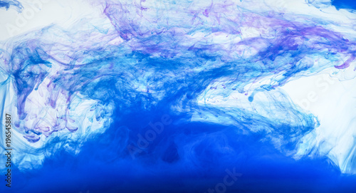 Acrylic colors and ink in water. Abstract frame background. Isolated on white. © ratnakorn