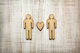 Two men with heart on wooden background - 196548422