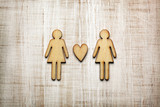 Two women with heart on wooden background - 196548445