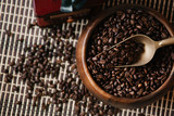 coffee beans in a wooden plate - 196556412