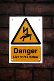 Danger sign on a brick wall