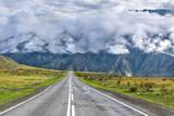 road mountains asphalt clouds