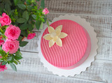 Pink chocolate velour cake decorated with flower