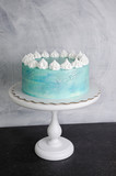 Light blue cream cheese cake with marshmallow and merengues - 196596445