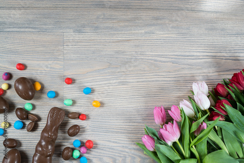 Delicious chocolate easter eggs ,bunny and sweets on dark wood background