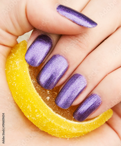 Foto op Canvas Manicure Fingers with a manicure and marmalade