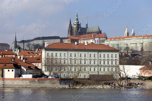 Early Spring Prague gothic Castle with the Lesser Town above River Vltava in the sunny Day, Czech Republic