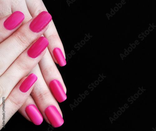 Fotobehang Manicure Pink manicure on a dark background. Copy space