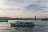 ISTANBUL, TURKEY - OCTOBER 09, 2015: boat sailing on river in evening