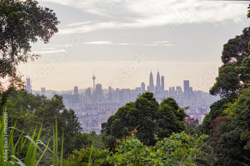 Kuala LumpurÕs famous skyline and skyscrapers in late afternoon framed by the thick jungle vegetation that surrounds the city