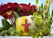 The flag of Nunavut on an cracked egg in a floral scene.(series)