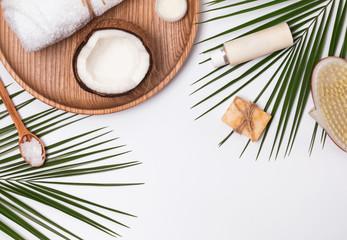 Body care producs, coconut and green leaves © Diana Vyshniakova