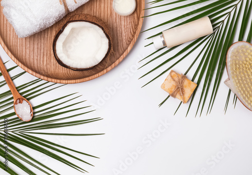 Body care producs, coconut and green leaves