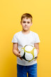 young boy with soccer ball
