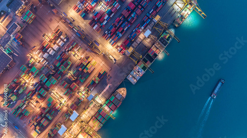 Foto Spatwand Thailand Container ship in export and import business and logistics. Shipping cargo to harbor by crane. Water transport International. Aerial view
