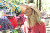 woman with colorful clothes outdoors at typical traditional market - 196651013