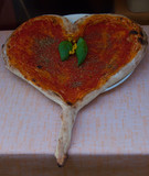 Pizza in the shape of a heart typically Italian food exposed outside a restaurant - 196655290
