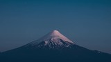 Sunset over volcano with stars in the night sky. Twilight to night , zoom out timelapse of the Volcano of Osorno. Patagonia, Chile - 196659624